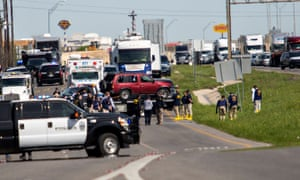 Police load Mark Conditt's vehicle onto a flatbed trailer in Round Rock, Texas, after the bombing suspect blew himself up.