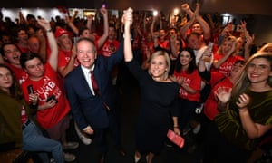 Labor leader Bill Shorten and the party's candidate for the seat of Longman Susan Lamb celebrate as they arrive at their election night function in Caboolture.