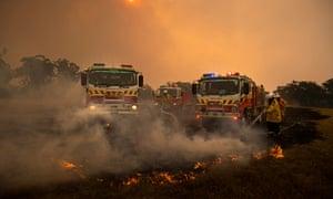 A spot fire on a grass paddock on the outskirts of Kulnura
