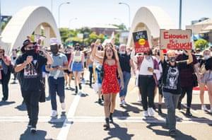 Protesters march through the Brisbane CBD