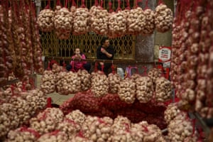 Vitoria Gasteiz, SpainSellers take lunch while preparing strings of garlic during the garlic fair. Every year a garlic market is held on St James's day in the Basque city, attracting producers from across Spain