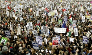 Hundreds of thousands of people march against the Iraq war.