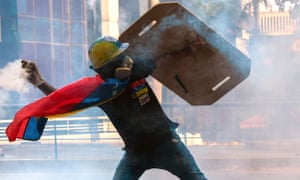 A protester battles riot police in Caracas, Venezuela, May 2017