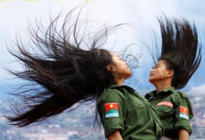 Dancers from the Wa community perform a traditional dance in the uniform of the United Wa State Army, the military force of the semi-autonomous region that covers northern Myanmar and part of China