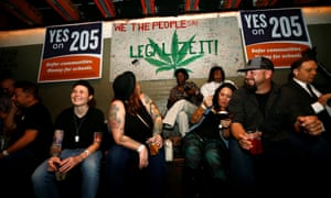 People gather for an election watch party put on by supporters of a legal marijuana initiative in Phoenix, Arizona. The proposition was defeated, with the pharmaceutical company Insys contributing $500,000 to the no campaign.