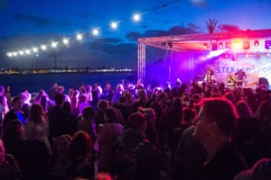 Partygoers at night at Pllek, Amstedam