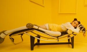 singer jaguar jonze lies on a backless lounge
