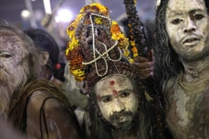 Sadhus cover themselves in ash for the event.