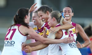Jessica Wuetschner is congratulated by her Lions teammates after kicking a goal against the Western Bulldogs in Melbourne on Saturday.