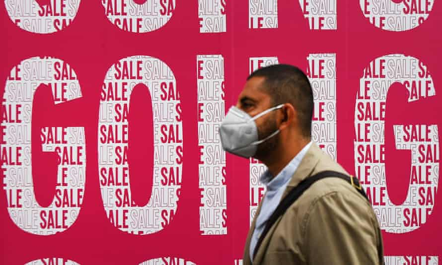 A pedestrian passes a sale sign outside a store in central London, 10 July 2020.
