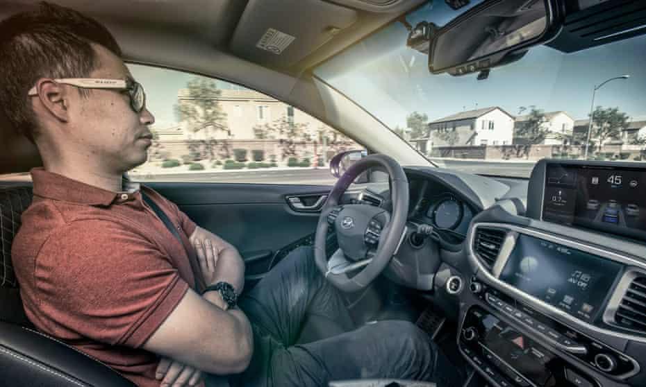 A human behind the wheel of Hyundai's Ionic driverless car.