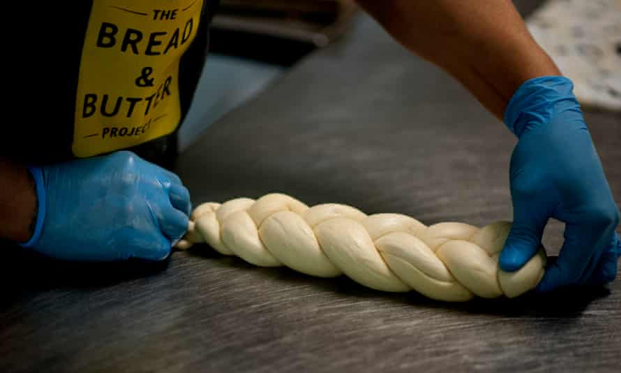 A braided loaf being assembled by the Bread and Butter project