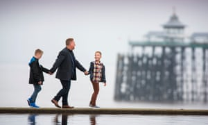 Singe with his sons at Clevedon beach, Somerset.