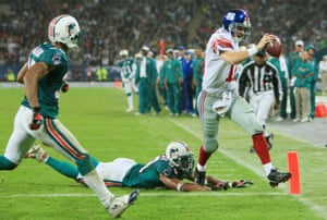 New York quarterback, Eli Manning outpaces Jason Taylor of the Dolphins to score the Giants only touchdown of the game.