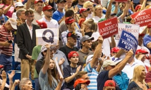 A Trump supporter holds up a QAnon sign in Tampa.