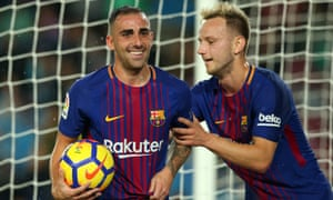 Paco Alcácer, left, celebrates scoring Barcelona's opening goal with Ivan Rakitic.