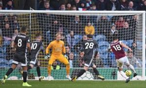 Burnley's midfielder Ashley Westwood (R) shoots past Leicester City's goalkeeper Kasper Schmeichel.