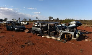 Car wrecks are seen on the outskirts of the Mutitjulu