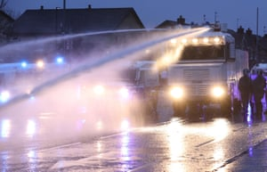 The PSNI use a water cannon