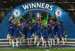 Chelsea players jump into the air with the trophy as captain Cesar Azpilicueta lifts 'old big ears'.