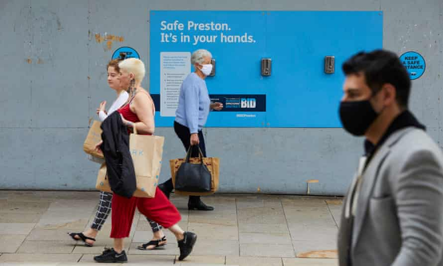 People wearing masks while shopping in the city centre in Preston.