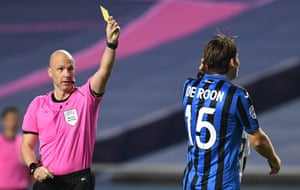 Referee Anthony Taylor shows yellow to de Roon.