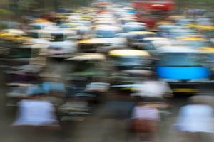 Cars in traffic jam in Mumbai during rush hour.