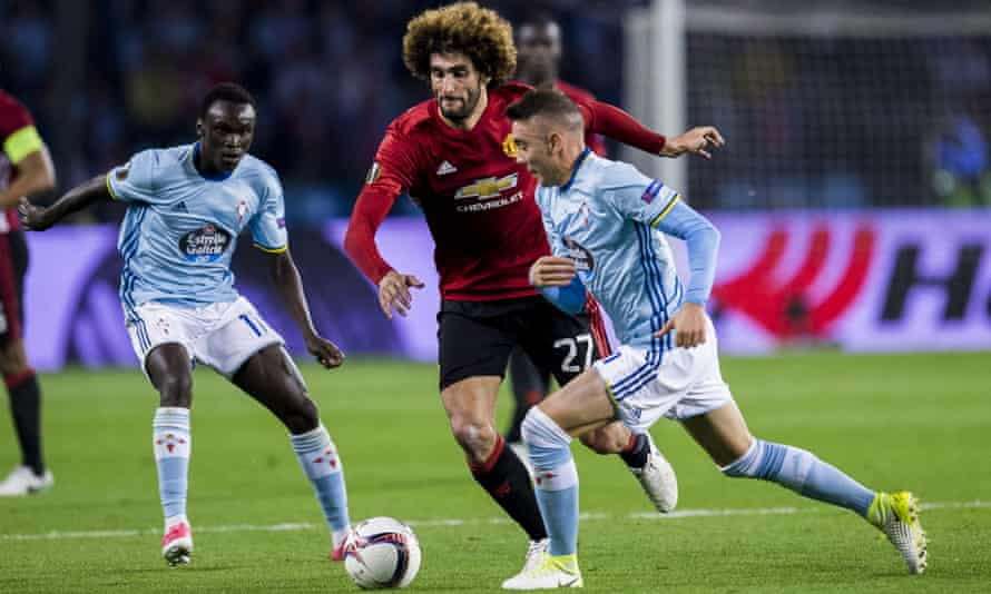 Celta Vigo's Iago Aspas battles for the ball with Marouane Fellaini of Manchester United in the Europa League semi-final first leg.