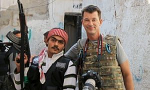 John Cantlie, right, poses with a Free Syrian Army rebel in Aleppo, Syria