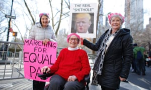 Women pose as they attend the second annual Women's March in New York City