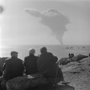 Onlookers watch the distant bombing of the stricken Torrey Canyon