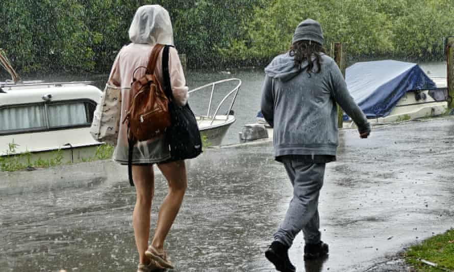 People walking on the Thames Path in the rain on Friday