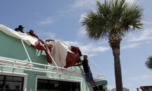Rich DiGiulio removes an awning from the Mulligans Beach House Bar & Grill in preparation for Hurricane Dorian, Friday, 30 August 2019, in Vero Beach, Florida.