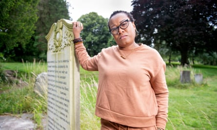 The poet Zakiya Mckenzie at the memorial to the enslaved people who died in a fire at a Baptist church in Bristol and were denied a proper burial until 1926.