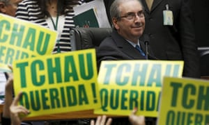 Lower house speaker Eduardo Cunha, the leader of the impeachment drive, observes anti-Rousseff congressmen with placards stating 'Bye Honey.'