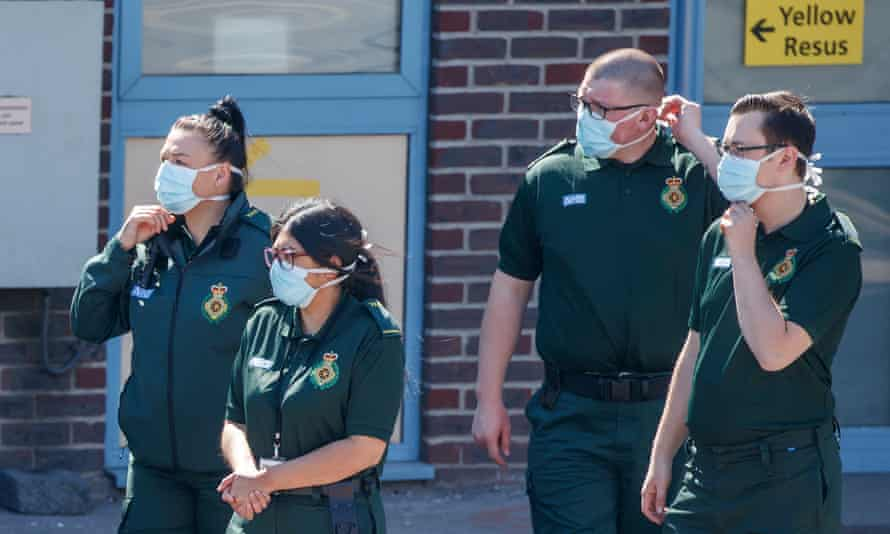 Ambulance crew members wear face masks outside Doncaster Royal Infirmary