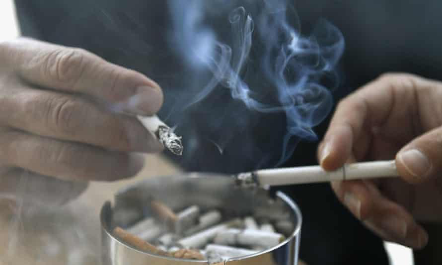 People smoking cigarettes.
