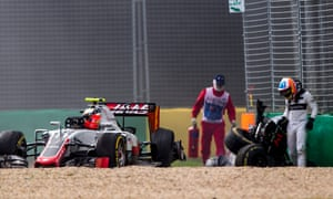 Fernando Alonso emerges from the wreckage of his crumbled McLaren.
