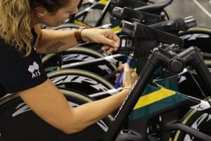A mechanic prepares bikes