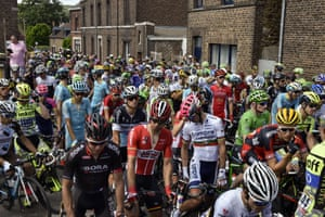 Riders wait as the race is neutralised