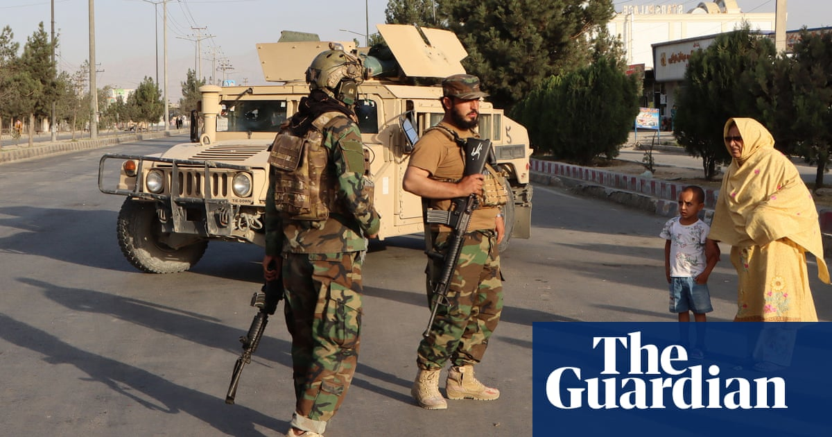 Taliban surround Kabul airport with extra forces after attack
