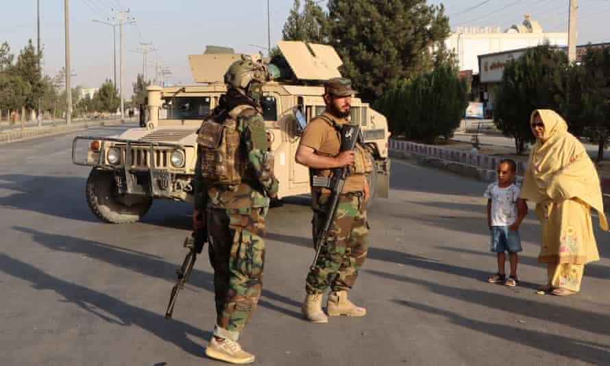 Taliban patrols outside the Hamid Karzai international airport in Kabul on Saturday