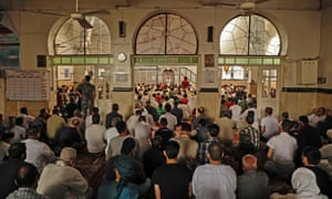 Syrians attend Eid prayers at a mosque in the city of Idlib