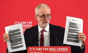 Jeremy Corbyn holding redacted documents of secret talks between the UK and US governments