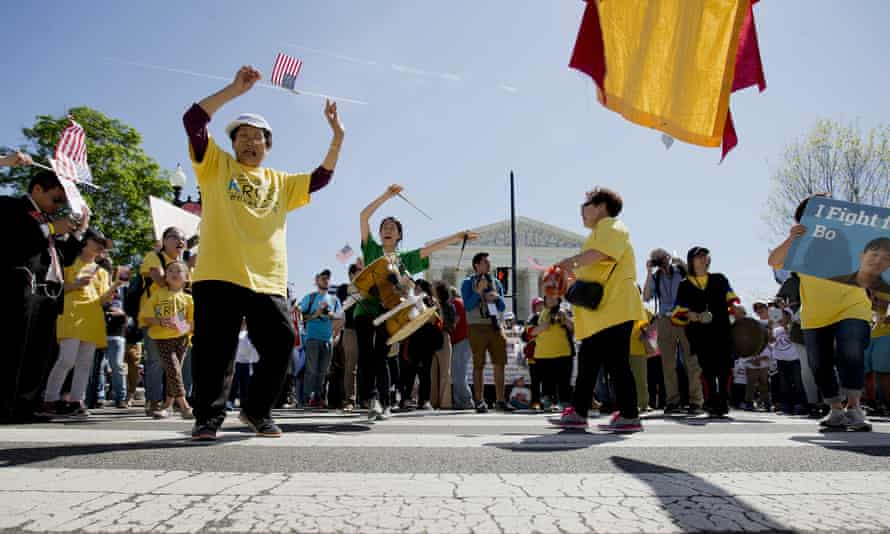 Supporters of fair immigration reform dance in the street in front of the supreme court on Monday.