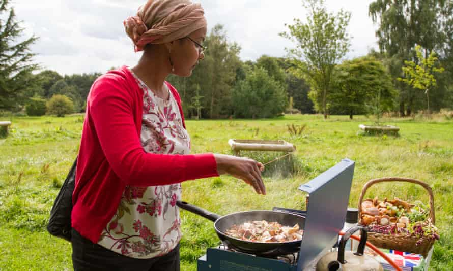 Field kitchen … Mina Said-Allsopp cooks during one of her Forage and Feast walks in Leeds.