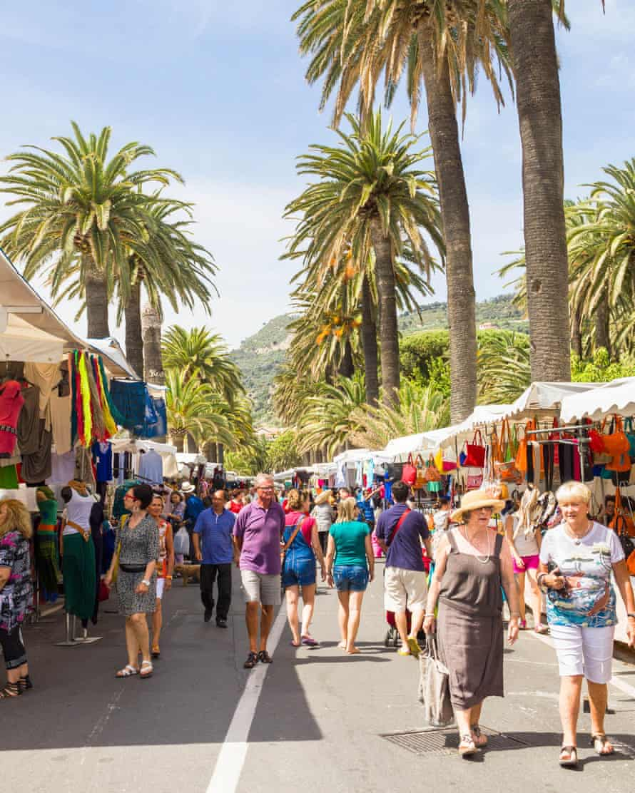 French tourists shop in the street market in Ventimiglia.