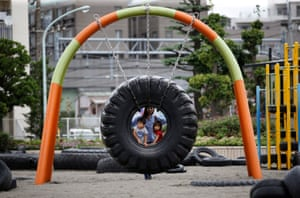 Tokyo, Japan Children ride on a swing made from a tyre at Nishi Rokugo Park, also known as Tyre Park, in Ota-Ku. The park features attractions made from thousands of recycled ttyres