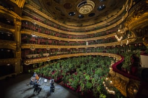 Barcelona, Spain: musicians from the UceLi string quartet perform Crisantemi by Puccini for an audience made up of 2,292 plants. The plants will be delivered to 2,292 healthcare professionals from the Hospital Clínic de Barcelona, accompanied by a certificate from the artist Eugenio Ampudia