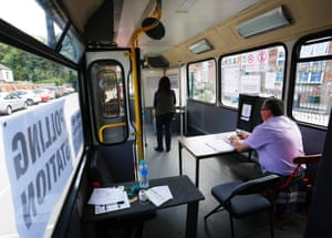 A resident casts her vote in a bus being used as a temporary polling station in Kingston-Upon-Hull, northern England
